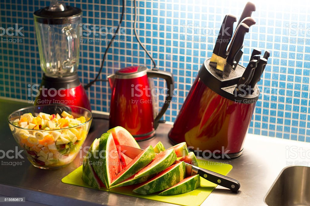 Fruit salad prepared on kitchen bench stock photo