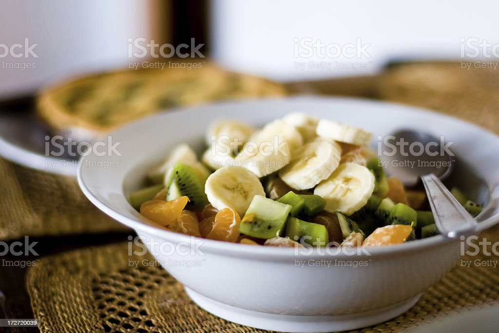 Fruit salad with spoon royalty-free stock photo