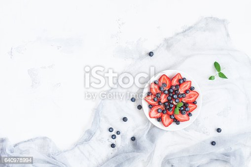 istock Fruit salad with strawberry and blueberry. Flat lay, top view 640978994