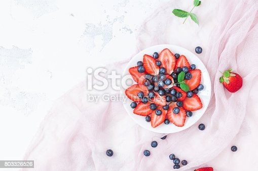 640978994 istock photo Fruit salad with strawberry and blueberry.  Flat lay, top view 803326526