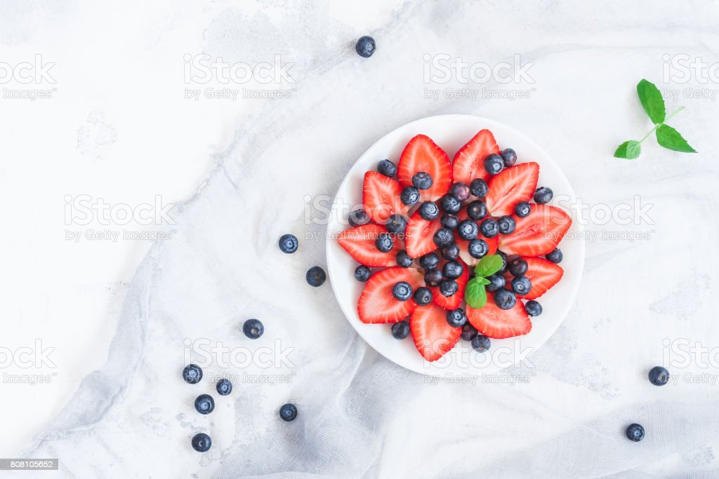 Fruit salad with strawberry and blueberry. Flat lay, top view stock photo