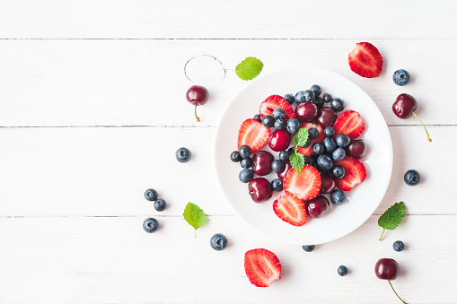 istock Fruit salad with strawberry, blueberry, sweet cherry 641210020