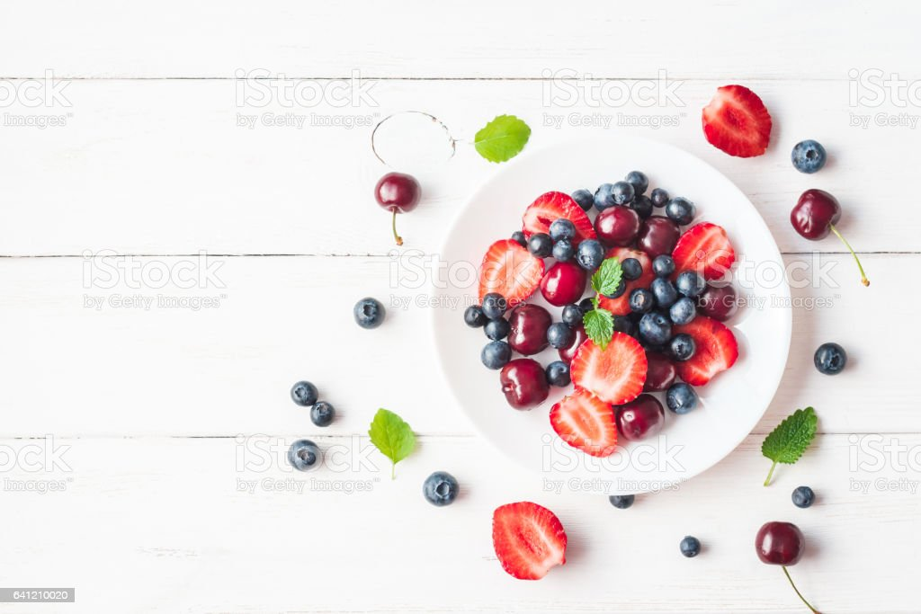 Fruit salad with strawberry, blueberry, sweet cherry stock photo