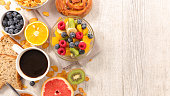 fruit salad,coffee and croissant