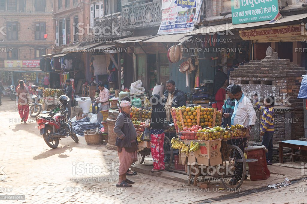 Fruit seller in the streets of Bhaktapur, Nepal stock photo