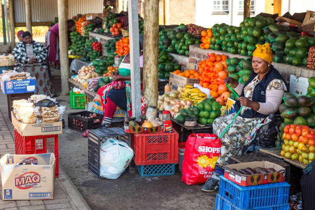 Fruit sellers selling fruit from market. stock photo