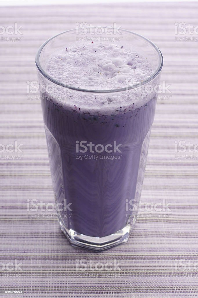 Fruit Smoothie on purple striped Background royalty-free stock photo