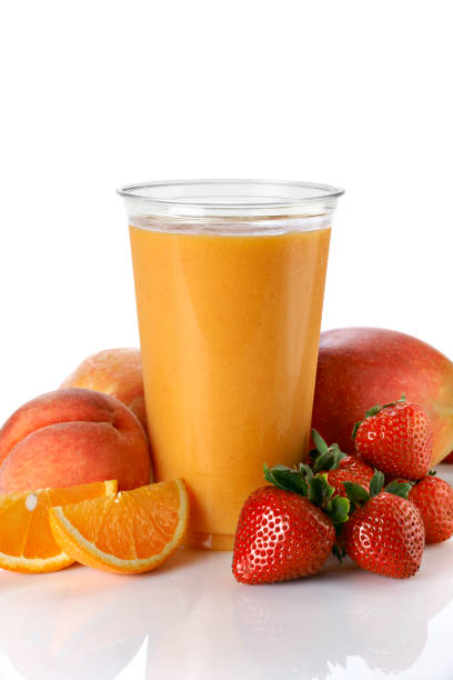 Fruit Smoothie with mango and peach stock photo