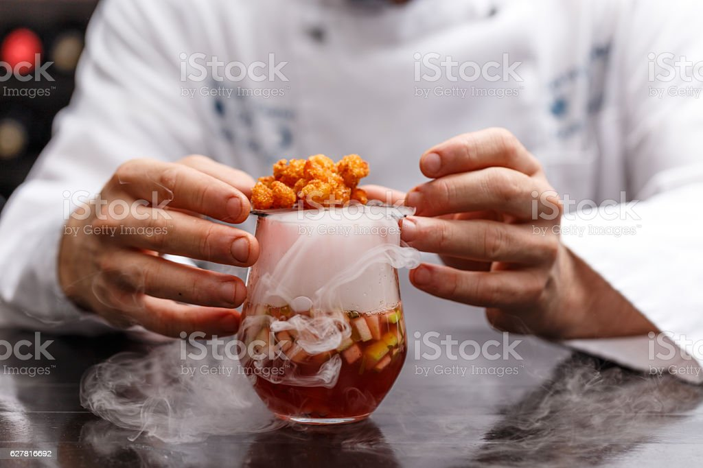 Fruit soup with dry ice stock photo