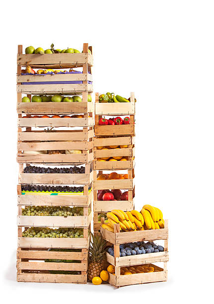 Fruit stored in wooden crates on white background stock photo