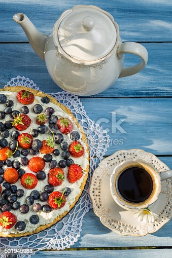 502634476 istock photo Fruit tart and coffee in the garden 501945983