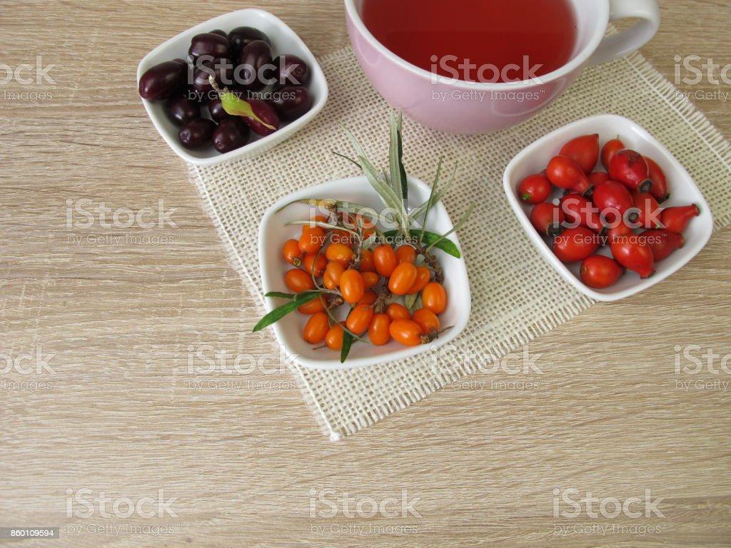 Fruit tea with cornelian cherry, rosehip and sea buckthorn stock photo