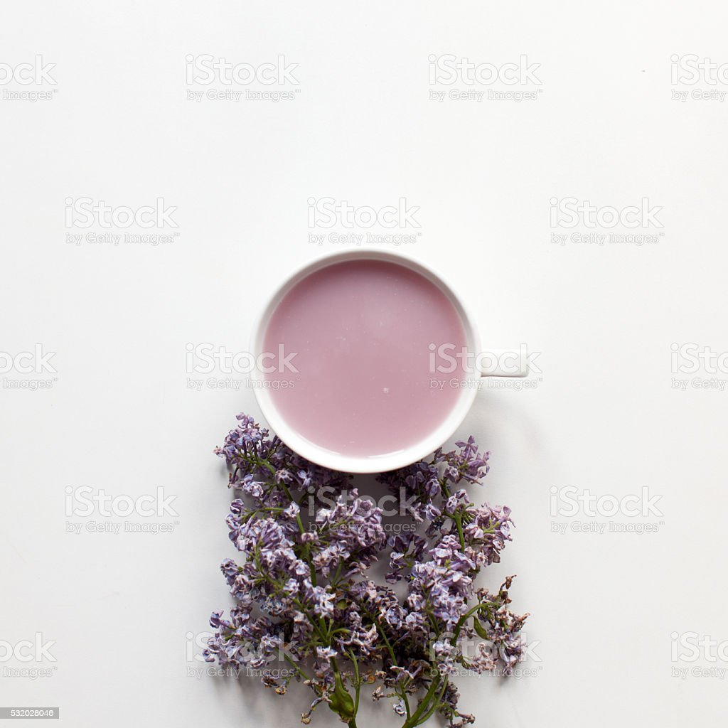 Fruit tea with milk and serenity flowers stock photo