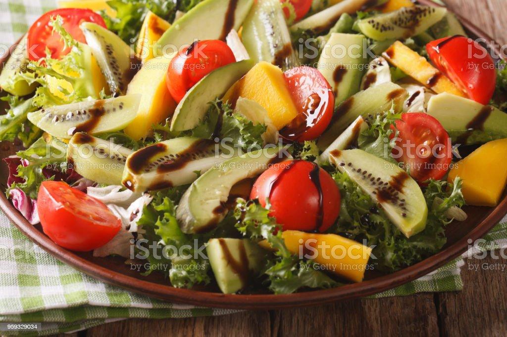 Fruit Vegetable Salad Of Mango Avocado Kiwi Tomato And Lettuce