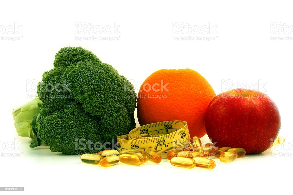 Fruit , vegetable, supplement and measure tape royalty-free stock photo