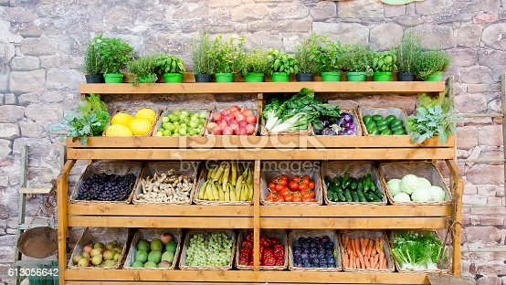 istock fruit vegetables shelves background 613056642