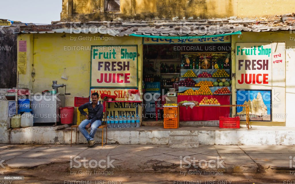 A fruit vendor and his shop near the Western Group of Temples stock photo
