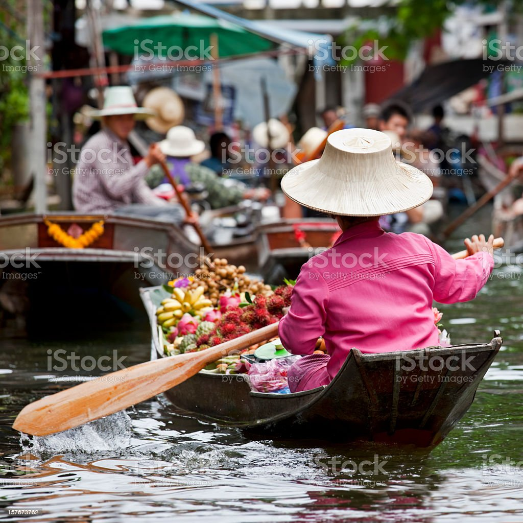 Fruit vendor at a floating market in Thailand stock photo