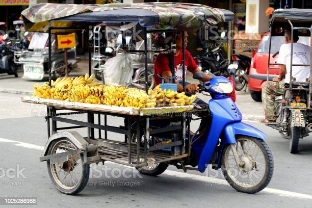 Fruit vendor sells bananas on his tricycle which is converted into a picture id1025286988?b=1&k=6&m=1025286988&s=612x612&h=xlvnzm2tzcfpscbntlc85p1d6cd34kj onn6wbddqti=