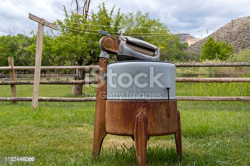 This scene come from Fruita, the preserved settlement now in the middle of Capitol Reef National Park.  This old time washing machine and clothesline are on display near an orchard and pasture.  In the background are the red cliffs that surround the Fruita settlement.