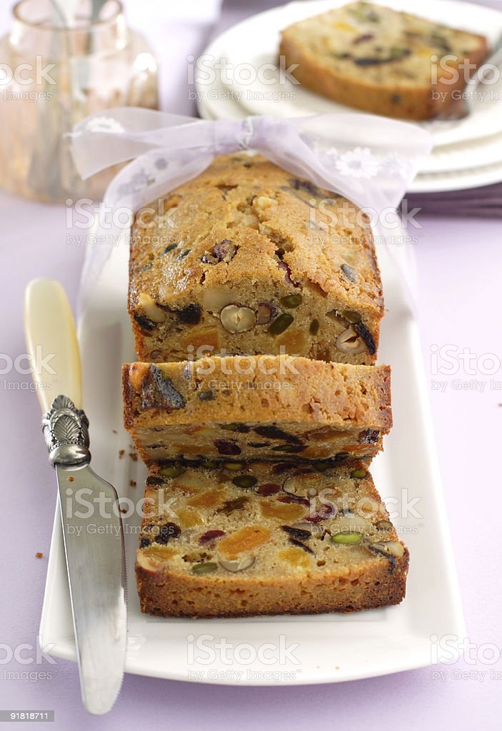 fruitcake partially cut in slices royalty-free stock photo
