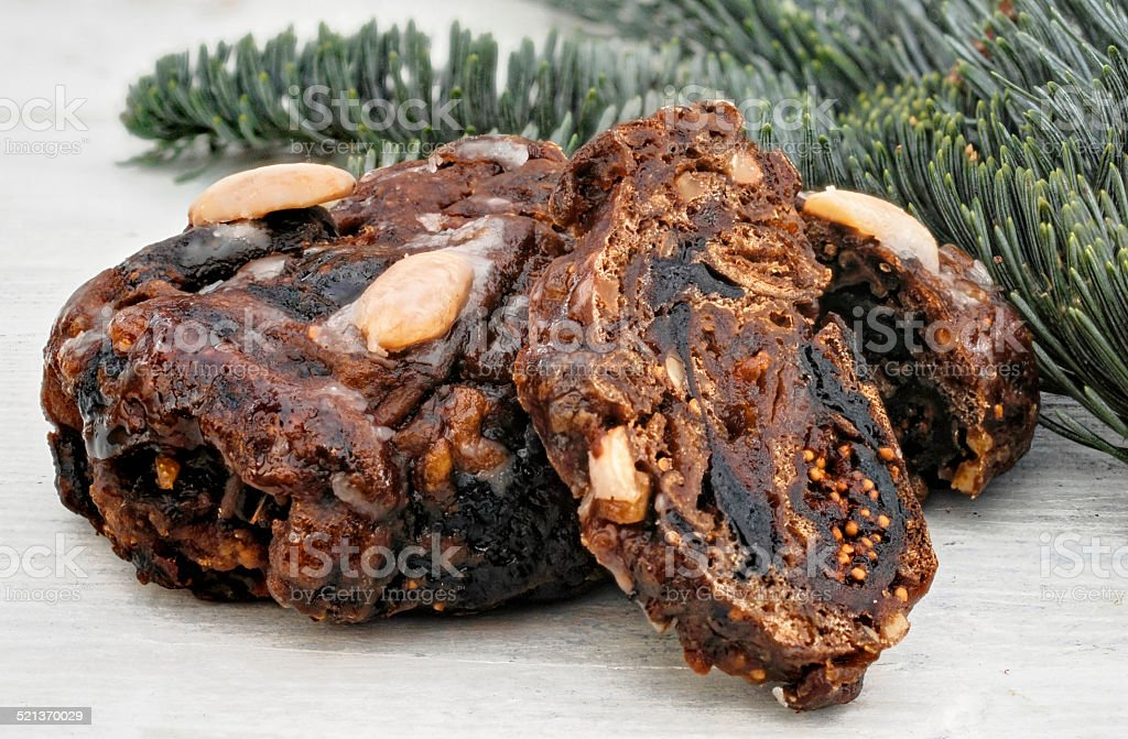 Fruitcake with fir branch stock photo
