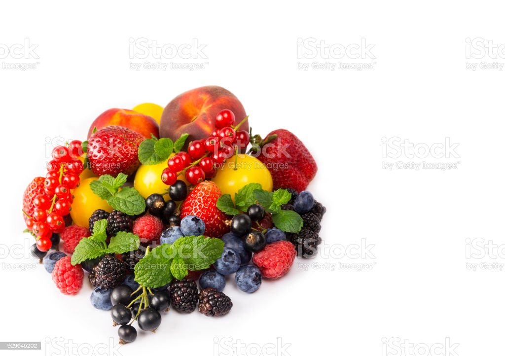 Fruits and berries isolated on white background. Ripe currants, strawberries, blackberries, bluberries, peaches and yellow plums. Sweet and juicy fruits at border of image with copy space for text. Various fresh summer. Background of mix fruits on a white stock photo