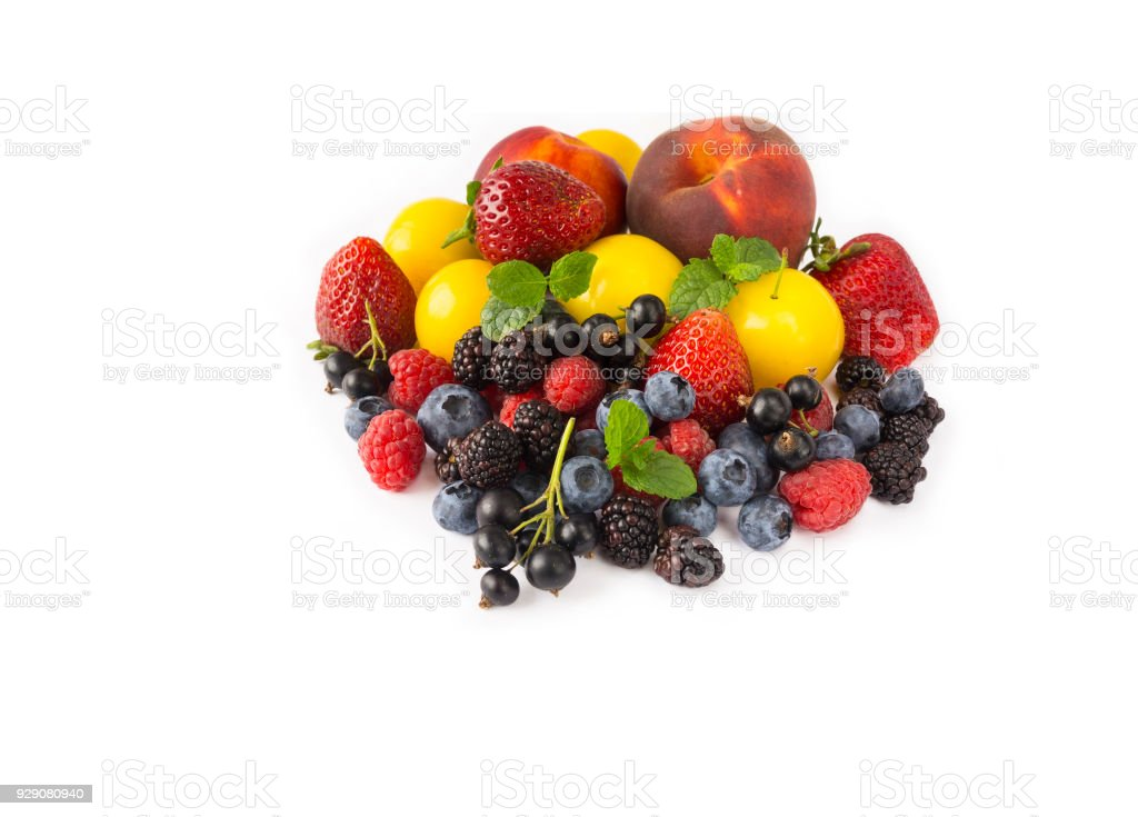 Fruits and berries isolated on white background. Ripe strawberries, blackberries, bluberries, peaches and yellow plums. Sweet and juicy fruits at border of image with copy space for text. Various fresh summer. Background of mix fruits on a white backgroun stock photo