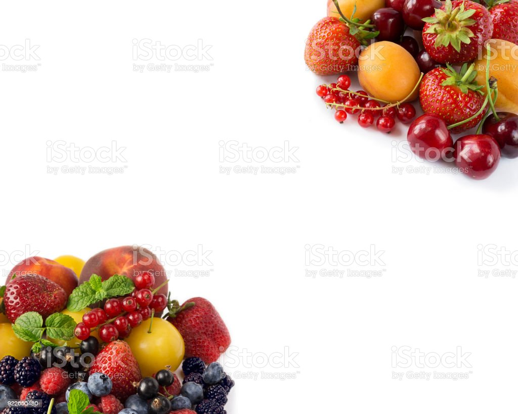 Fruits and berries on white background. Sweet and juicy fruits at border of image with copy space for text. Ripe apricots, currants, cherries, strawberries, blackberries, bluberries, peaches and yellow plums. Various fresh summer. Background of mix fruits stock photo