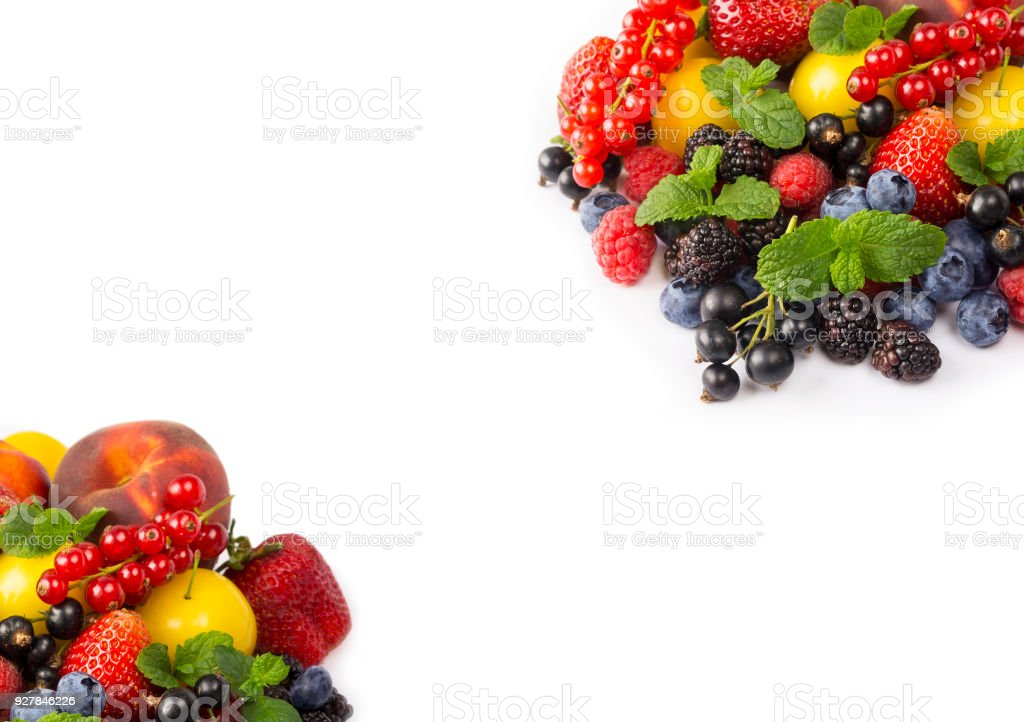 Fruits and berries on white background. Sweet and juicy fruits at border of image with copy space for text. Ripe currants, strawberries, blackberries, bluberries, peaches and yellow plums. Various fresh summer. Background of mix fruits on a white backgrou stock photo
