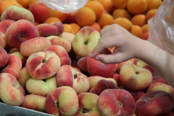 fruits and child hand - pesche bambino foto e immagini stock