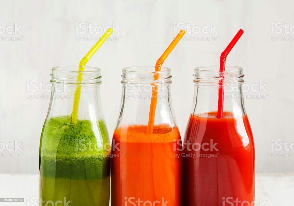 Fruits and vegetable juice in bottle. - Photo