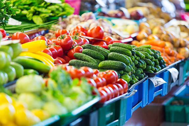 fruits and vegetables at city market in riga - bazaar stockfoto's en -beelden
