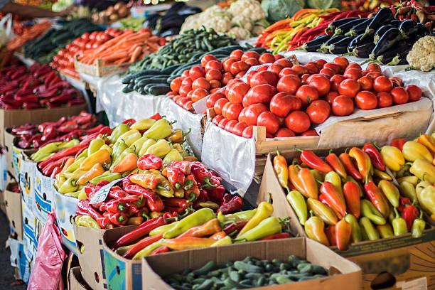 fruits and vegetables at city market - bazaar stockfoto's en -beelden