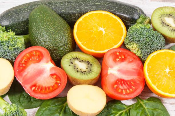 fruits and vegetables containing vitamin k, potassium, natural minerals and dietary fiber - буква k стоковые фото и изображения