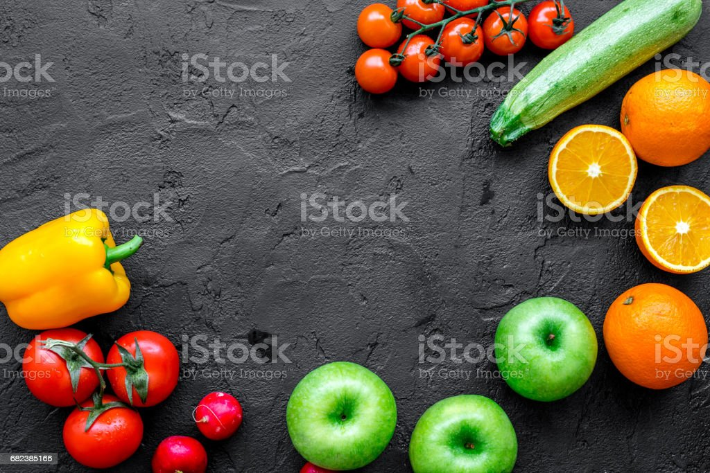 fruits and vegetables for healthy dinner on dark background top view mock up foto stock royalty-free