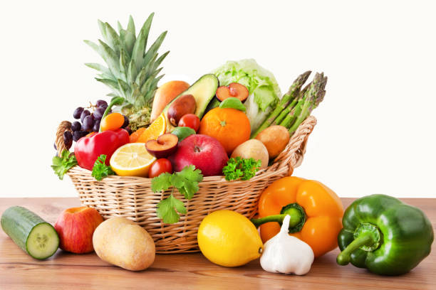 Fruits and vegetables in a basket stock photo