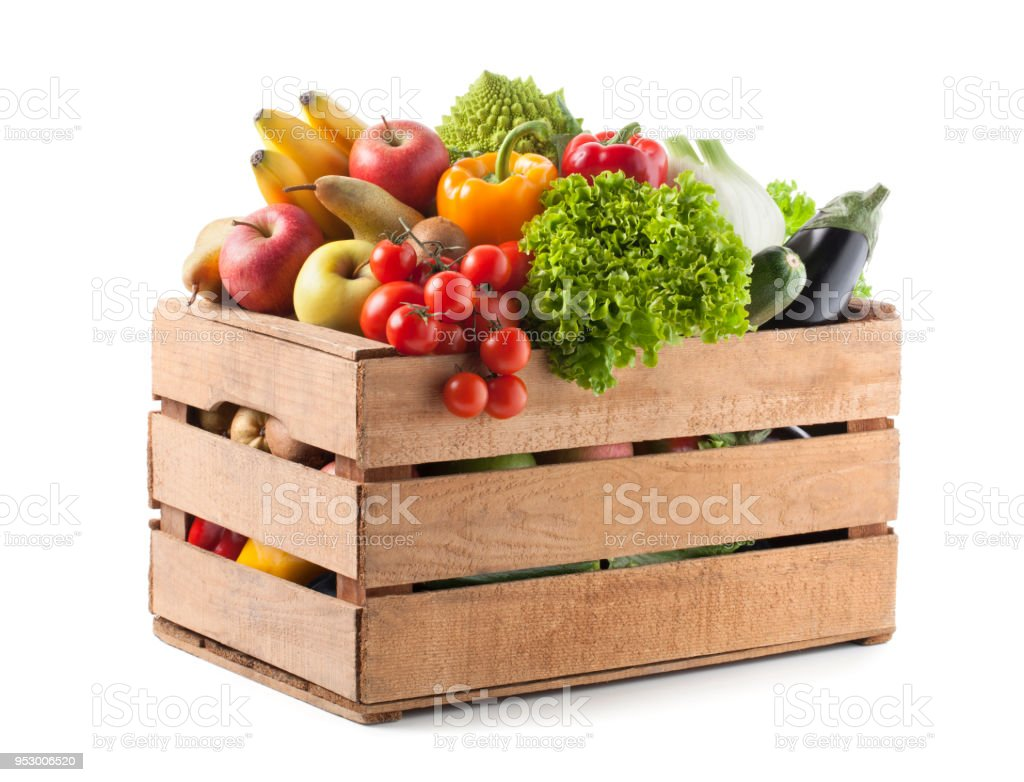 Fruits and vegetables in a wooden crate on white background