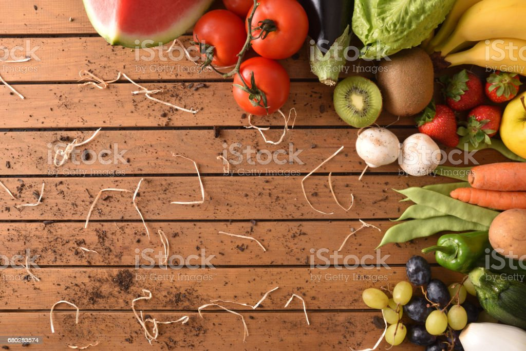 Fruits and vegetables in the corner a wood table top stock photo