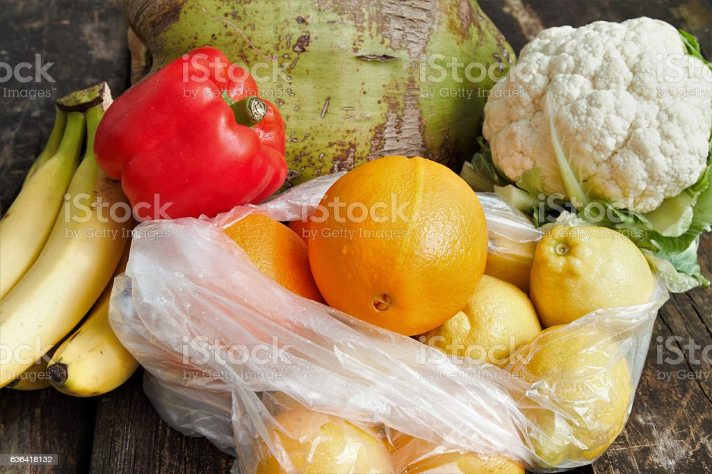 Fruits and vegetables including bananas, oranges, lemons, coconut,...