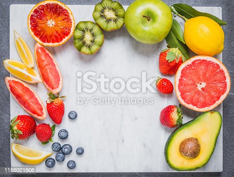 istock Fruits and vegetables ingredients for healthy diet top view on white marble table copy space. 1155021505