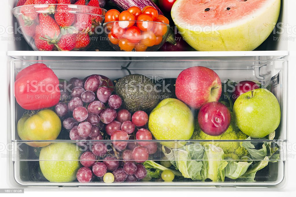 Fruits and vegetables inside fridge stock photo