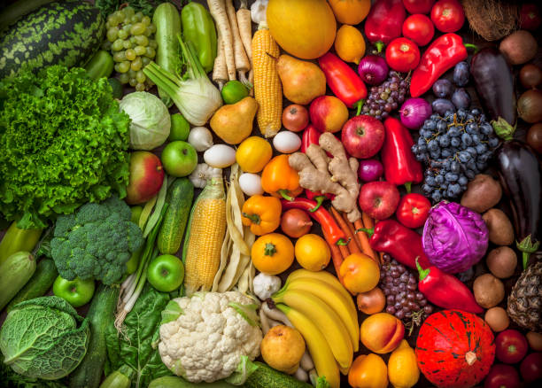 Fruits and vegetables large overhead colorful mix green to red stock photo