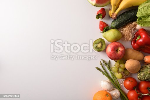 istock Fruits and vegetables on a white table top view 680283604