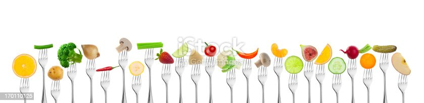 Large Group Fruits and Vegetables on Fork isolated on White, Selective Focus, 16.500 x 4.000 Pixels File..