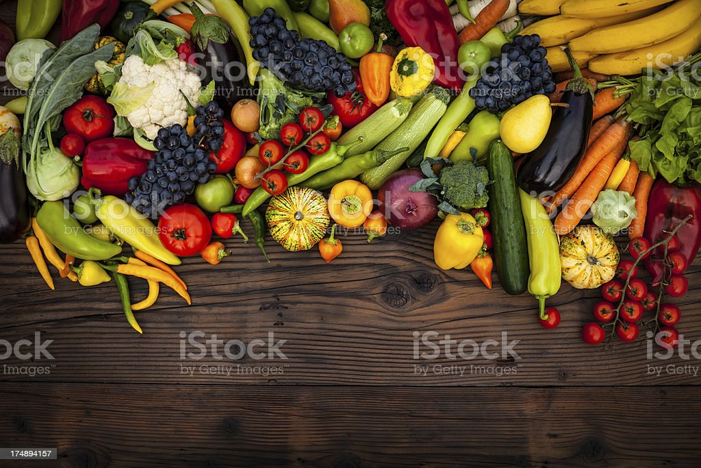 Fruits and vegetables on wood table stock photo