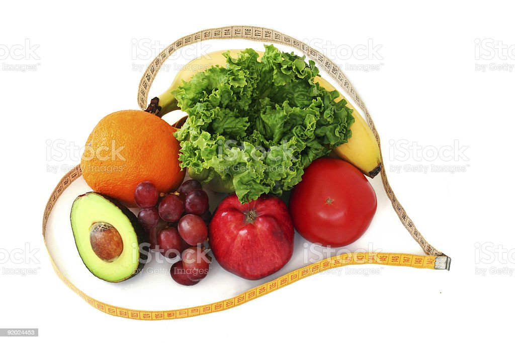 Fruits and veggies in heart tape stock photo