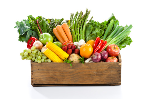 Assortment of Fruits and Vegetables Inside Wood Box Isolated on White Background. Front View.