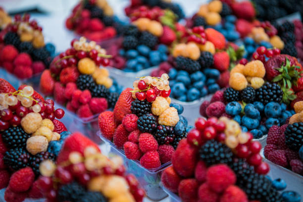 Fruits, berries and vegetables on the counter at the street market Fruits, berries and vegetables on the counter at the street market berry stock pictures, royalty-free photos & images