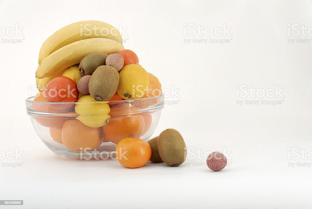 Fruits in a glass bowl royalty-free stock photo